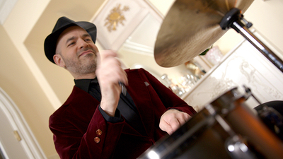 Alegria drummer performing live in a ballroom