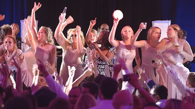 Attraction bridesmaids dancing at a wedding with band performing live