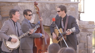 Bent Mountain Trio band performs at a vineyard with guitar bass and banjo