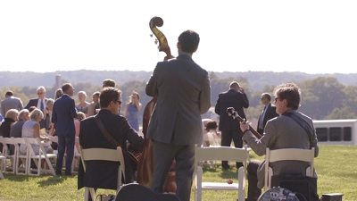Bent Mountain Trio band plays music during wedding at an outdoor vineyard