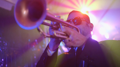 Revue male trumpet player performing live for audience