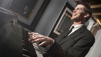 Revue male keyboard player playing live for private event
