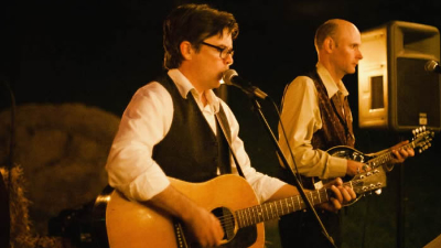 Charles King Arthur male singer and guitar player perform for outdoor farm wedding