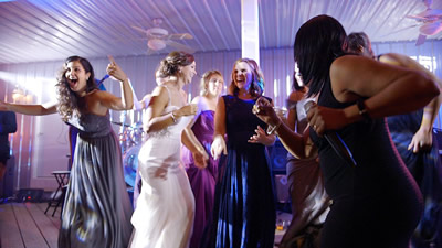 Crystal Clear Band bride and guests dancing at a wedding reception