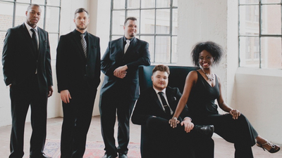 Downtown Collective promotional photo formal dressed in black