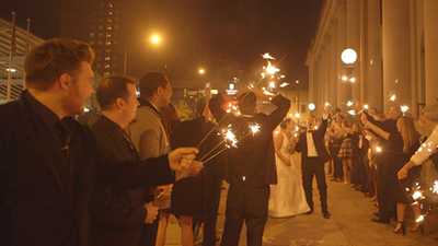 Downtown Collective couple leaving for honeymoon and band entertaining guests