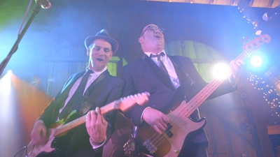 E3 guitar and bass player performing live for corporate event