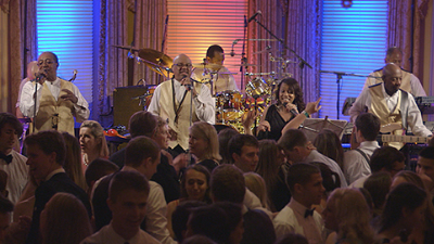 Horizon live band on stage while guests dance at private event