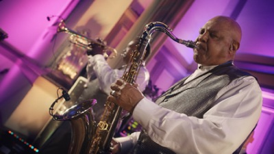 Horizon male saxophone player performing live for private event