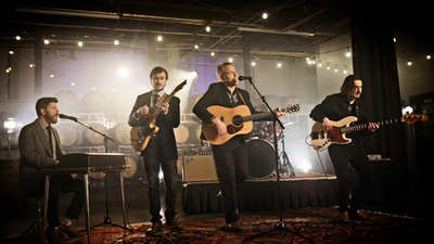 Jackson Flats band performs on stage for live college event