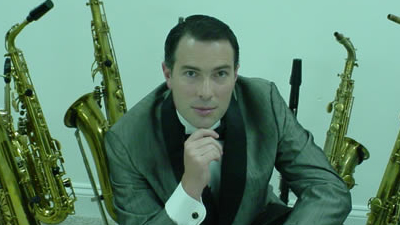 Jeff Decker Band promotional photo of solo male with saxophones