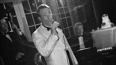 Jeff Decker Band singer in tux performs for a wedding reception