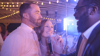 Lucky Pocket male singer shares microphone with wedding couple