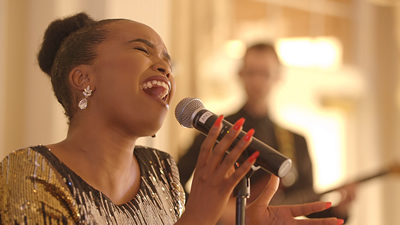 New Royals The female vocalist performs for formal corporate event