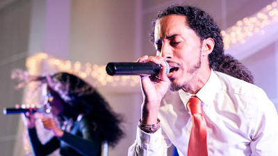 New Royals The male singer performs on stage for wedding
