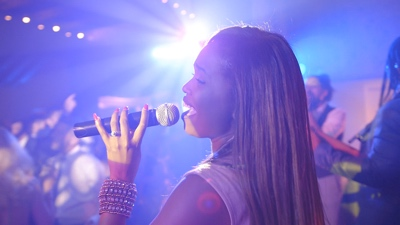 New Royals The female singer performing live for a corporate event