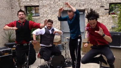 OnLive promotional photo of band jumping and entertaining