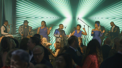 Queen City Band band performs live for audience at a corporate event