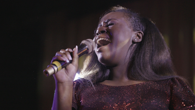 Queen City Band lead female singer performing live for a party