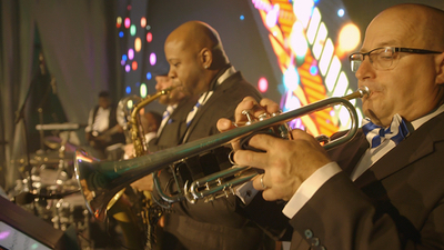 Queen City Band horn section performing live for a wedding