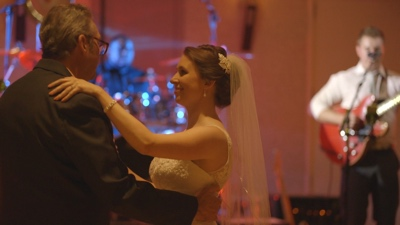 Radio Sparks The bass player performing for couples first dance at wedding