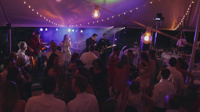 RadioJacks live performance at a wedding party with guests singing and dancing