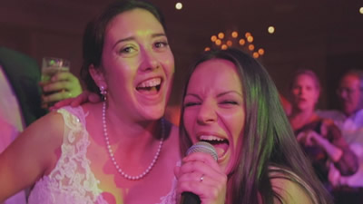 Real Geniuses The bride singing and dancing with lead female band singer