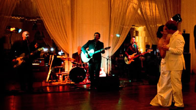Jangling Reinharts The  band performs for couples first dance in a ballroom