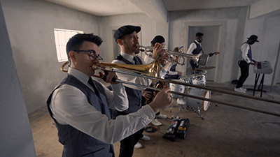 Revel Radio horn players entertain at a corporate ballroom