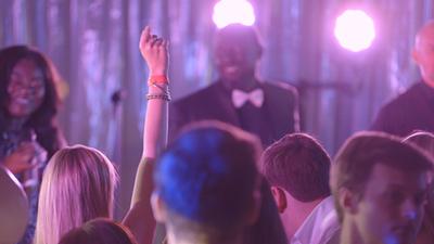 Seven Til Sunrise guests dancing and singing at a wedding reception