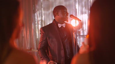 Seven Til Sunrise lead male singer performing live for guests at a corporate event
