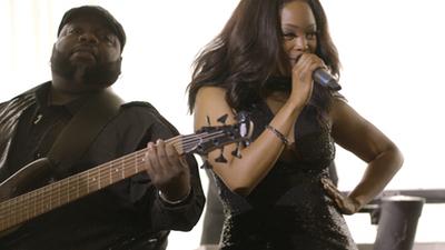 Seven Til Sunrise female singer performing live with bass player