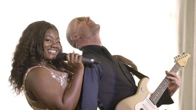 Seven Til Sunrise female singer and guitar player performing live in ballroom