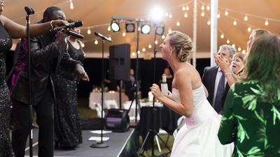 Seven Til Sunrise band performing live for bride at a wedding reception