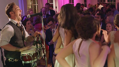 Significant Others The bridesmaids dance on stage with bongo player