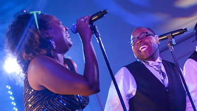 Soul Expressions male and female singers performing live at a wedding reception with guitar player