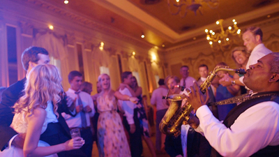 Soul Expressions Saxophone player performs on ballroom dance floor with guests
