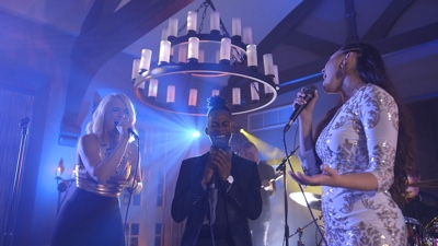 Young Hearts trio singers performing live at a concert