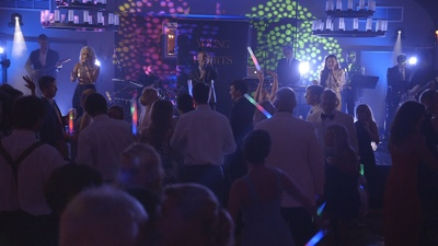 Young Hearts band live performance in front of guests at a corporate event