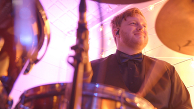 Young Hearts male drummer performing live at a corporate event
