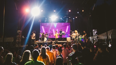 Young Hearts band performing live in front of audience at live concert